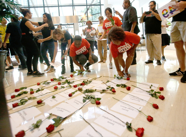 Names of the 49 victims of the Pulse nightclub shooting are placed on the floor with a rose outside U.S. Sen. Marco Rubio's Orlando office to pressure him to take action on gun violence during a s ...