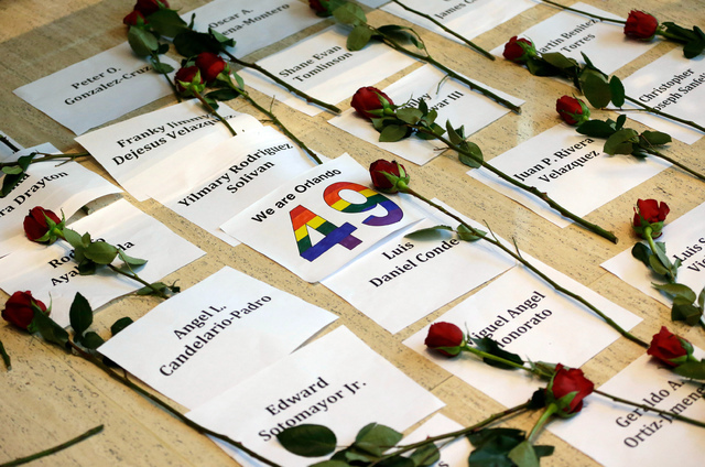 Several of the names of the 49 victims of the Pulse nightclub shooting are seen as they are placed on the floor outside U.S. Sen. Marco Rubio's Orlando office to pressure him to take action on gun ...