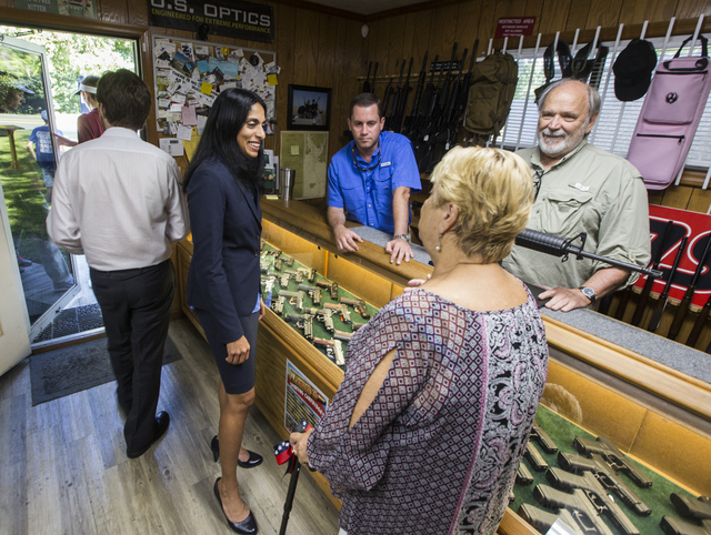 Republican candidate for Florida's Second Congressional District Mary Thomas, right, talks to supporters at DSH Firearms in Tallahassee, Fla., on July 19, 2016. (AP Photo/Mark Wallheiser)
