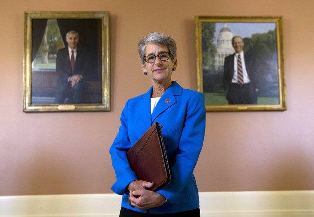 California state Sen. Hannah-Beth Jackson, D-Santa Barbara, poses in front of portraits of two former California governors, Republicans George Deukmejian, left and Pete Wilson, at the Capitol in S ...