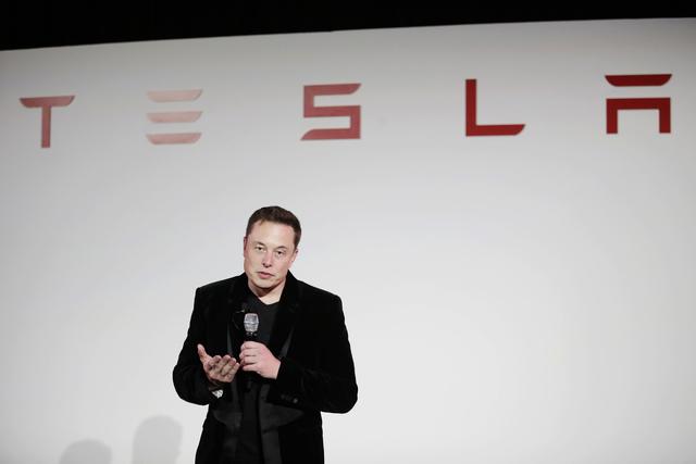 Elon Musk, CEO of Tesla Motors Inc., talks about the Model X car at the company's headquarters, in Fremont, Calif., Sept. 29, 201. (Marcio Jose Sanchez/AP)