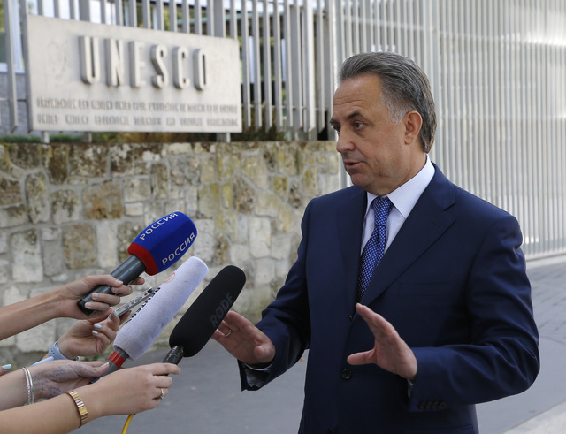 Russian Sports Minister Vitaly Mutko answers reporters after a meeting with the working group, the Bureau for the convention on anti-doping, at the Unesco headquarters in Paris, Monday, Aug. 1, 20 ...