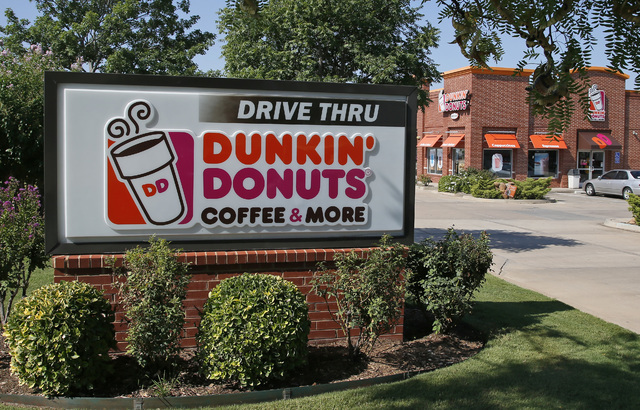 This Thursday, July 28, 2016, photo shows a Dunkin' Donuts in Edmond, Okla. Already, the emergence of smaller rivals promising more wholesome alternatives has major restaurant chains scrambling to ...
