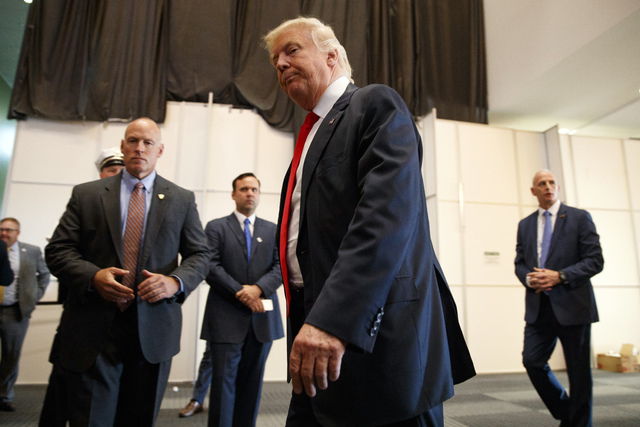 Republican presidential candidate Donald Trump walks away after speaking to reporters before a town hall event, Monday, Aug. 1, 2016, in Columbus, Ohio . (AP Photo/Evan Vucci)