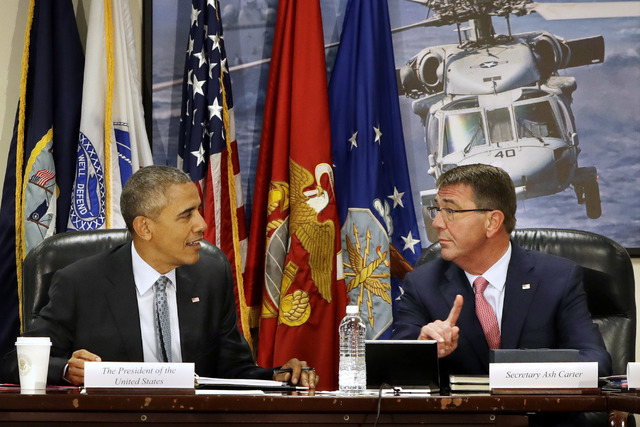 President Barack Obama speaks with Defense Secretary Ash Carter at the start of a National Security Council Meeting on the counter-Islamic State group campaign, Thursday, Aug. 4, 2016, at the Pent ...