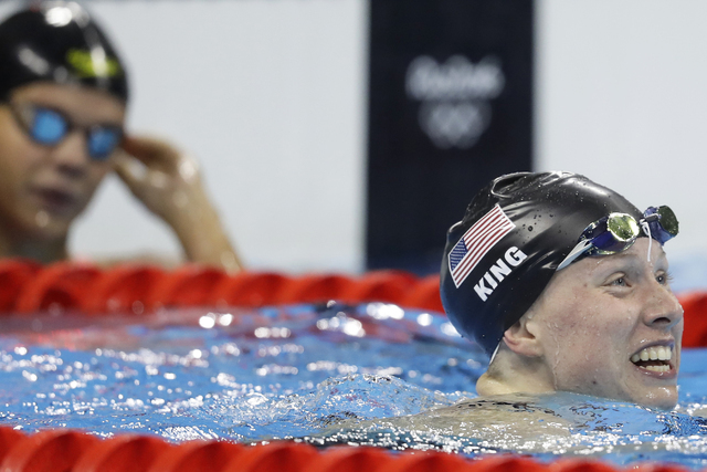 Russia's Yulia Efimova, left, looks on as United States' Lilly King celebrates after winning the gold medal in the women's 200-meter breaststroke final during the swimming competitions at the 2016 ...