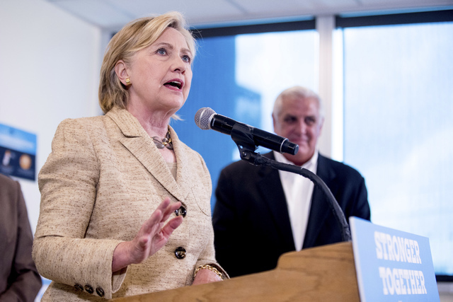 Democratic presidential candidate Hillary Clinton speaks to medical professionals after taking a tour of Borinquen Health Care Center, in Miami, Fla., Tuesday, Aug. 9, 2016, to see how they are co ...