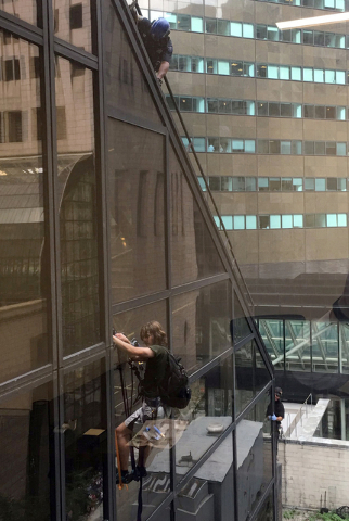 A man scales the all-glass face of Trump Tower in New York, Wednesday, Aug. 10, 2016. The 58-story building is headquarters to the Republican presidential nominee's campaign. He also lives there.  ...