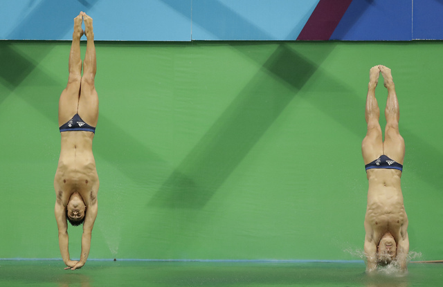 Britain's Jack Laugher and Chris Mears compete during the men's synchronized 3-meter springboard diving final in the Maria Lenk Aquatic Center at the 2016 Summer Olympics in Rio de Janeiro, Brazil ...