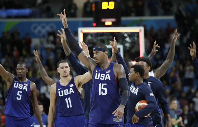 United States' Carmelo Anthony (15) and teammates walk off the court after their win over Australia in a men's basketball game at the 2016 Summer Olympics in Rio de Janeiro, Brazil, Wednesday, Aug ...