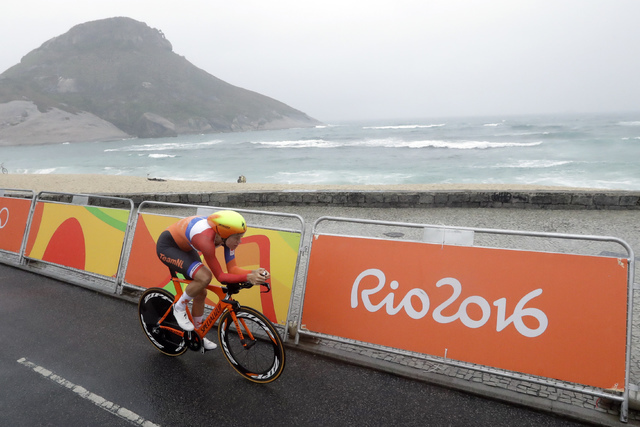 Cyclist Ellen van Dijk of Netherlands rides along Pontal beach during the women's individual time trial event at the 2016 Summer Olympics in Rio de Janeiro, Brazil, Wednesday, Aug. 10, 2016. (AP P ...