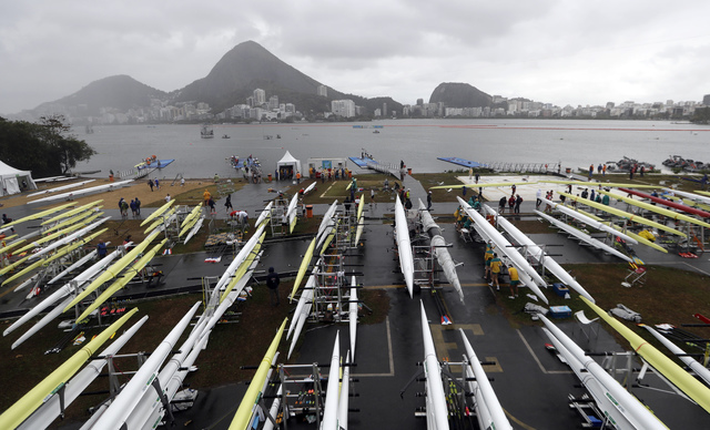 Boats are stored in the team area during a weather postponement during the 2016 Summer Olympics in Rio de Janeiro, Brazil, Wednesday, Aug. 10, 2016. (AP Photo/Luca Bruno)