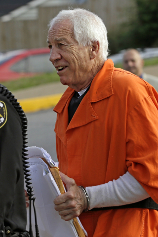 Former Penn State University assistant football coach Jerry Sandusky arrives at the Centre County Courthouse for an appeals hearing about whether he was improperly convicted four years ago, in Bel ...