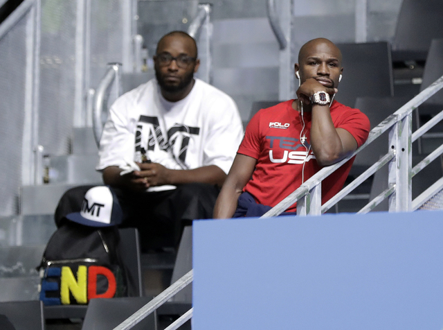 Boxer Floyd Mayweather Jr., right, watches boxing matches at Riocentro during the 2016 Summer Olympics in Rio de Janeiro, Brazil, Saturday, Aug. 13, 2016. (Frank Franklin II/Associated Press)