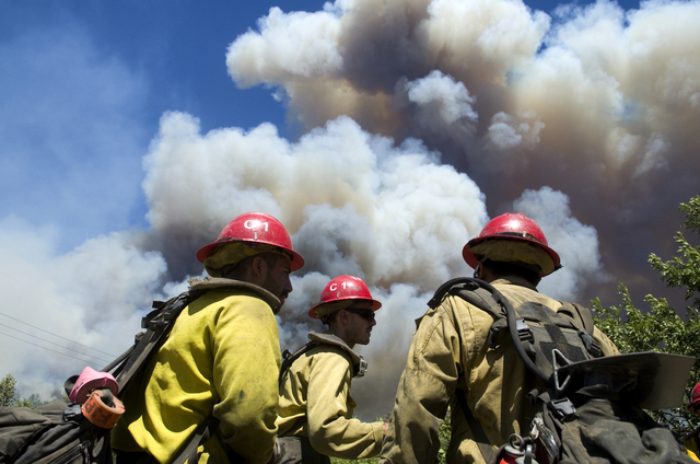 U.S. Forest Service firefighters stage before getting their assignment to cover a wildfire falls near the Cajon Pass in California, Tuesday, Aug. 16, 2016. (James Quigg/The Daily Press via AP)