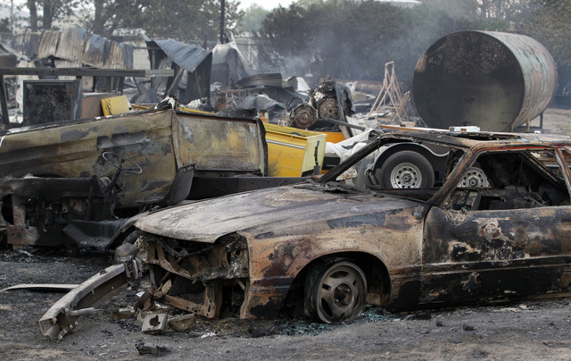 Burned property at Hess Road and Highway 138 shows the devastation of the BlueCut fire in West Cajon Valley, Calif., Wednesday, Aug. 17, 2016. (AP Photo/Alex Gallardo)
