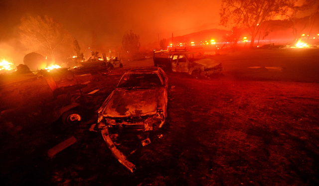 A wildfire burns in the Cajon Pass in San Bernardino county, Calif., on Tuesday, Aug. 16, 2016. The wildfire that began as a small midmorning patch of flame next to Interstate 15 in the Cajon Pass ...