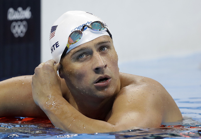 In this Tuesday, Aug. 9, 2016, file photo, United States' Ryan Lochte checks his time in a men's 4x200-meter freestyle heat during the swimming competitions at the 2016 Summer Olympics, in Rio de  ...