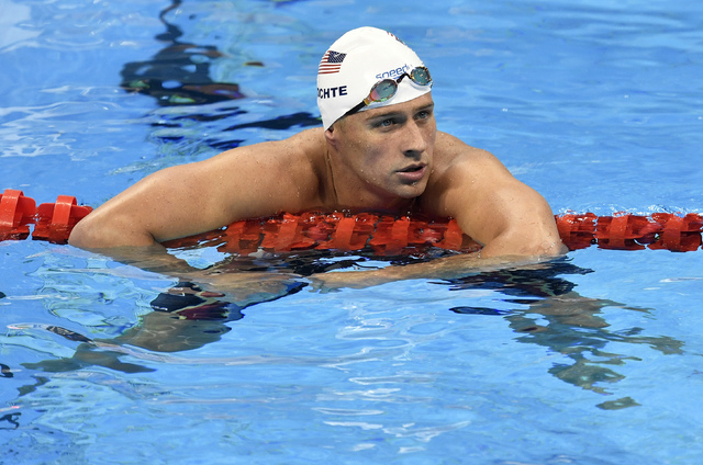 In this Aug. 9, 2016, file photo, United States' Ryan Lochte checks his time after a men' 4x200-meter freestyle relay heat during the swimming competitions at the 2016 Summer Olympics in Rio de Ja ...