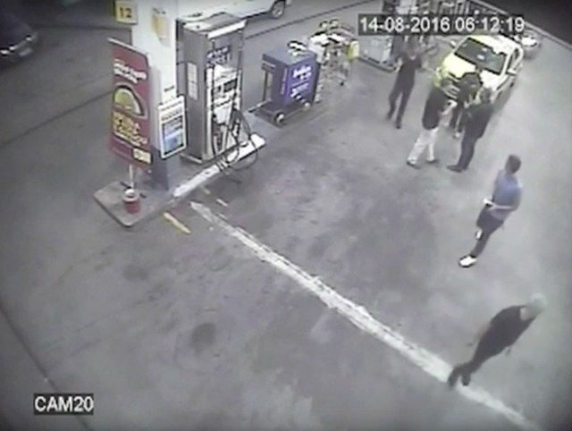 In this Sunday, Aug. 14, 2016 frame from surveillance video released by Brazil Police, swimmers from the United States Olympic team appear with Ryan Lochte, right, at a gas station during the 2 ...