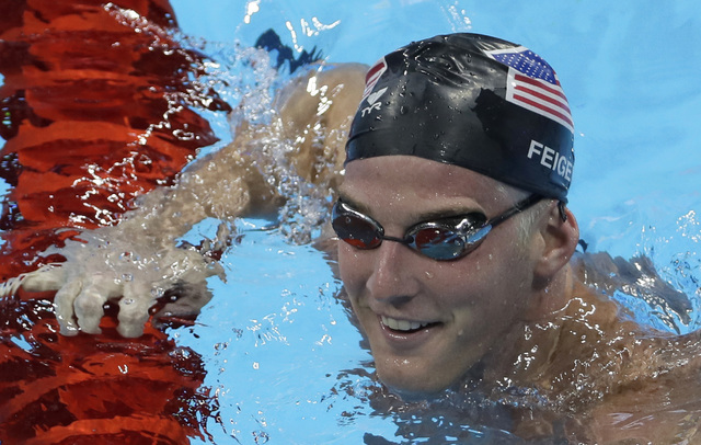 James Feigen smiles during a swimming training session prior to the 2016 Summer Olympics in Rio de Janeiro, Aug. 2, 2016. Feigen was one of four American Olympic swimmers in connection to a story  ...