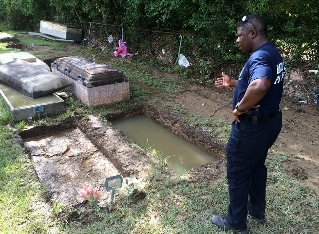 In this image made from video, Willie Brooks III says speaks about the grave of his grandmother and how it's gone due to flooding, Thursday, Aug. 18, 2016, in Plainview Cemetery in Denham Springs, ...