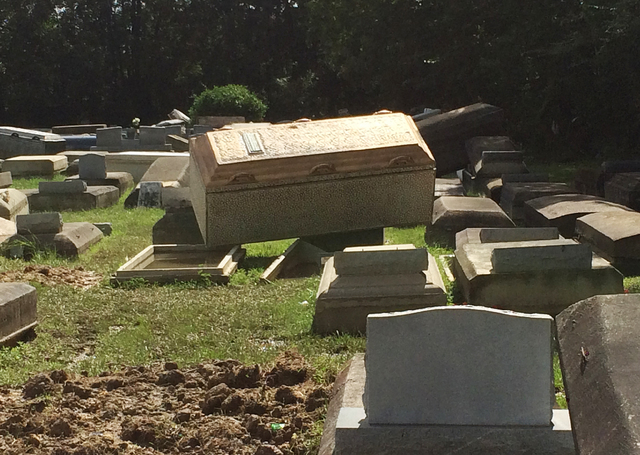 In this image made from video, coffins lie unearthed Thursday, Aug. 18, 2016, in Plainview Cemetery in Denham Springs, La. (Joshua Replogle/AP)