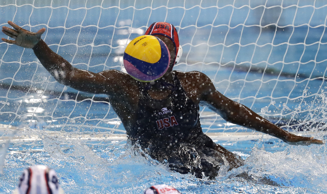 United States' Ashleigh Johnson makes a save during women's gold medal water polo match against Italy at the 2016 Summer Olympics in Rio de Janeiro, Brazil, Friday, Aug. 19, 2016. (Sergei Grits/AP)