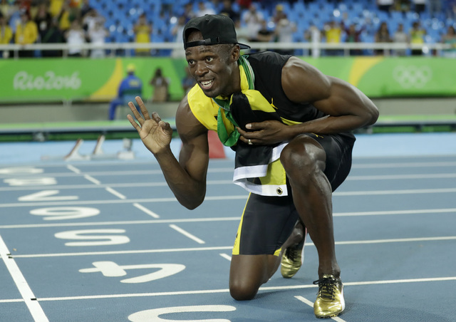 Jamaica's Usain Bolt celebrates winning the gold medal in the men's 4 x 100-meter relay final, during the athletics competitions of the 2016 Summer Olympics at the Olympic stadium in Rio de Janeir ...