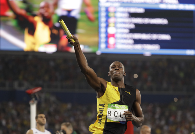 Jamaica's Usain Bolt celebrates winning the gold medal in the men's 4x100-meter relay final during the athletics competitions of the 2016 Summer Olympics at the Olympic stadium in Rio de Janeiro,  ...