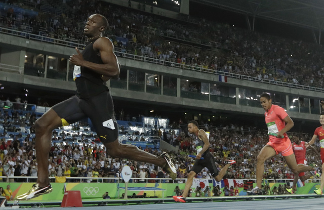 Jamaica's Usain Bolt crosses the line to win gold in the men's 4x100-meter final during the athletics competitions of the 2016 Summer Olympics at the Olympic stadium in Rio de Janeiro, Brazil, Fri ...