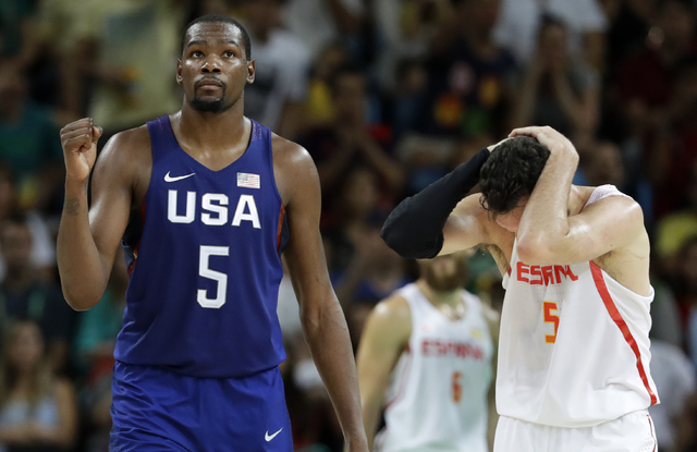 United States' Kevin Durant, left, reacts in front of Spain's Rudy Fernandez, right, during a semifinal round basketball game at the 2016 Summer Olympics in Rio de Janeiro, Brazil, Friday, Aug. 19 ...