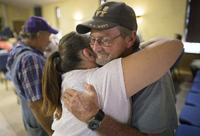 Charles Craft, 57, right, gets a hug from Tammie Lovelady, 49, before church service at South Walker Baptist Church in Walker, La., Sunday, Aug. 21, 2016. Craft, a member of South Walker Baptist,  ...