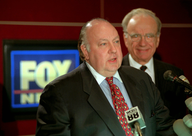 In this Jan. 30, 1996 file photo, Roger Ailes, left, speaks at a news conference as Rupert Murdoch looks on after it was announced that Ailes will be chairman and CEO of Fox News. Former Fox News  ...