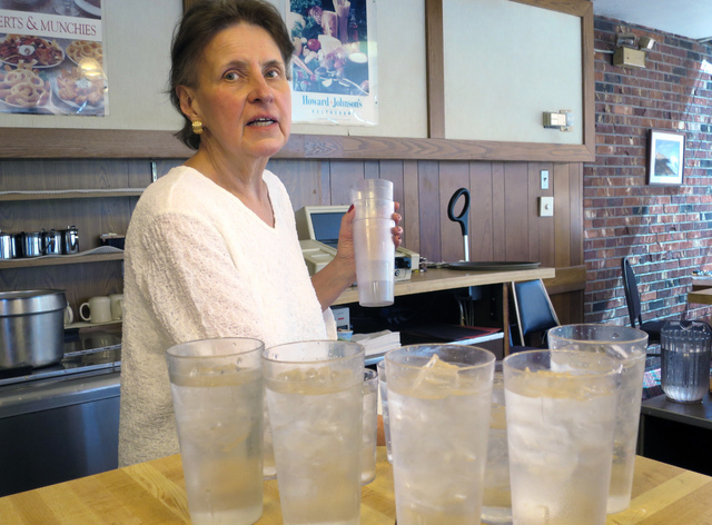Kathe Jewett, 68, a waitress at Howard Johnson's in Bangor, Maine since it opened in 1966, fills water glasses at the restaurant, Tuesday, Aug. 23, 2016. (David Sharp/AP)