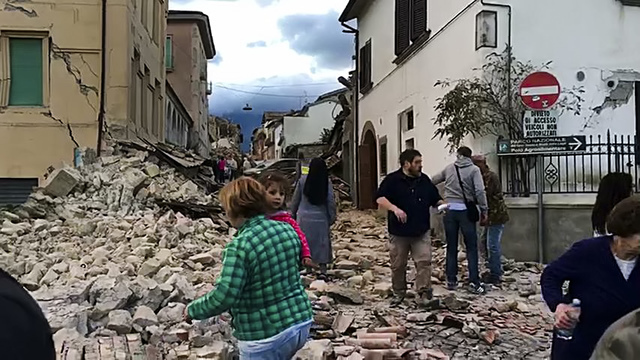 This still image taken from video shows survivors and rescuers wandering in the center of Amatrice, central Italy, where a 6.1 earthquake struck just after 3:30 a.m., Wednesday, Aug. 24, 2016. (AP ...