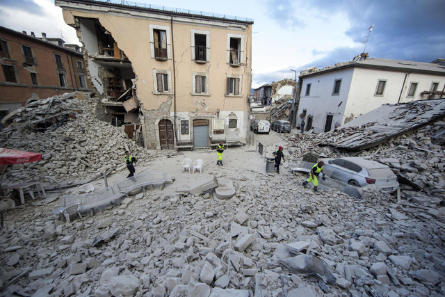 The side of a building is collapsed following an earthquake, in Amatrice Italy, Wednesday, Aug. 24, 2016.(Massimo Percossi/ANSA via AP)