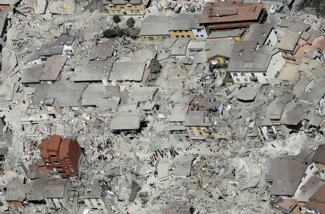 This aerial photo shows the damaged buildings in the town of Amatrice, central Italy, after an earthquake, Wednesday, Aug. 24, 2016. The magnitude 6 quake struck at 3:36 a.m. local time and was fe ...