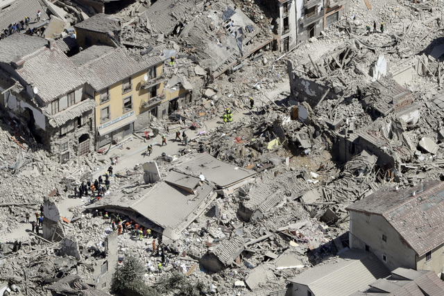 Rescuers search amid rubble following an earthquake in Amatrice Italy, Wednesday, Aug. 24, 2016. The magnitude 6 quake struck at 3:36 a.m. and was felt across a broad swath of central Italy. (AP P ...