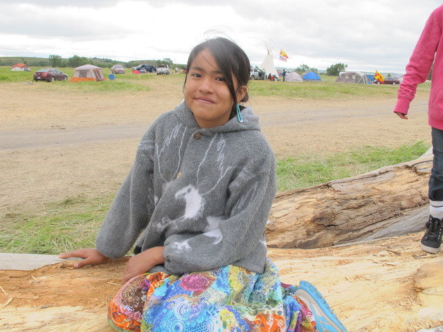 Wambli Johnson poses for photo at an oil pipeline protest near the Standing Rock Sioux reservation in southern North Dakota on Thursday, Aug. 25, 2016. The 11-year-old donated $150 to protest orga ...