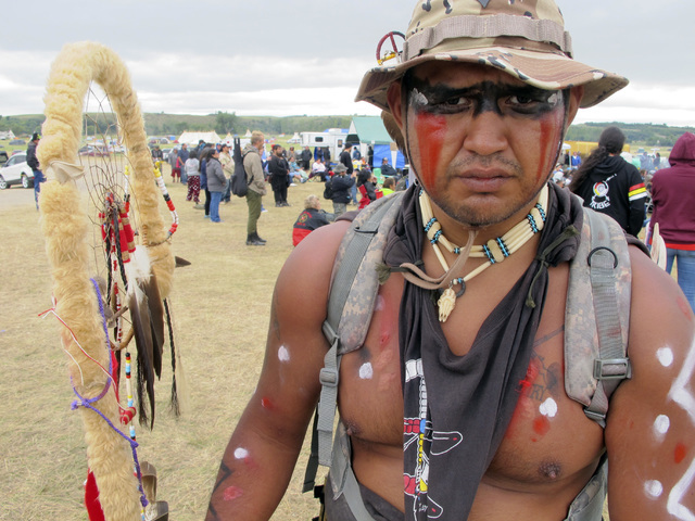 Jon Don Ilone Reed, an Army veteran and member of South Dakota's Cheyenne River Sioux Tribe, poses for a photo at an oil pipeline protest near the Standing Rock Sioux reservation in southern North ...