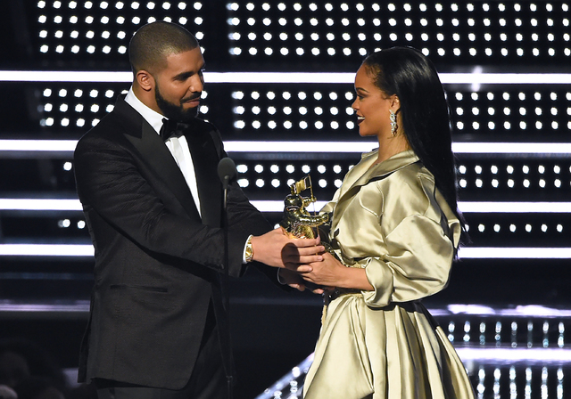 Drake, left, presents the Michael Jackson Video Vanguard Award to Rihanna at the MTV Video Music Awards at Madison Square Garden on Sunday, Aug. 28, 2016, in New York. (Charles Sykes/AP)