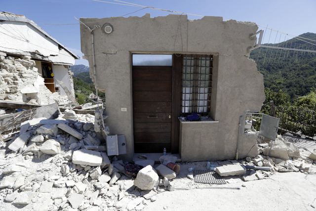 The door of a collapsed house in Peschiera Del Tronto, central Italy, Monday, Aug. 29, 2016. Italian authorities are pondering how to provide warmer, less temporary housing for quake homeless livi ...