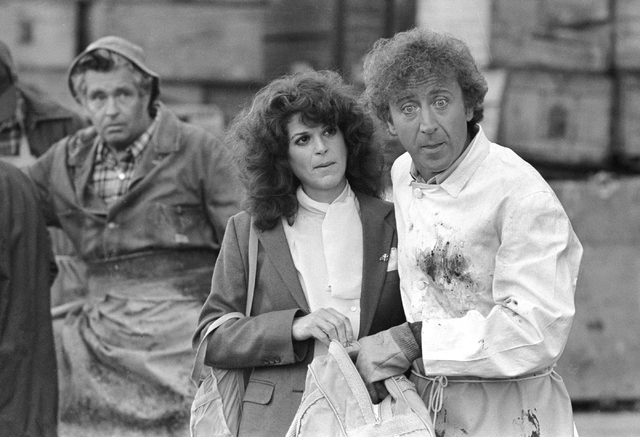 "Gilda Radner, center, and Gene Wilder, right, perform in a scene from the film ""Hanky Panky,"" directed by Sidney Poitier in Boston, Aug. 27, 1981. Wilder died Sunday, Aug. 28, 2016, at 83. (Bill P ..."