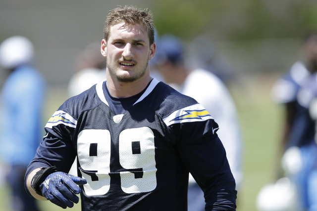 In this May 13, 2016, file photo, San Diego Chargers rookie defensive end Joey Bosa trains during an NFL football rookie training camp in San Diego. Bosa's holdout has overshadowed everything else ...