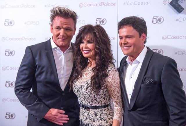 Gordon Ramsay and Flamingo headliners Marie Osmond and Donny Osmond arrive at Caesars Palace's 50th anniversary celebration Saturday, Aug. 6, 2016, in Las Vegas. (Tom Donoghue)