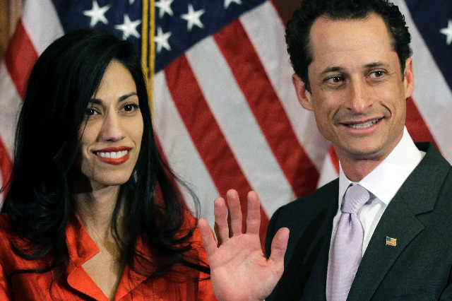 In this Jan. 5, 2011, file photo, Anthony Weiner and his wife, Huma Abedin, pose for photographs after the ceremonial swearing in of the 112th Congress on Capitol Hill in Washington. (AP)