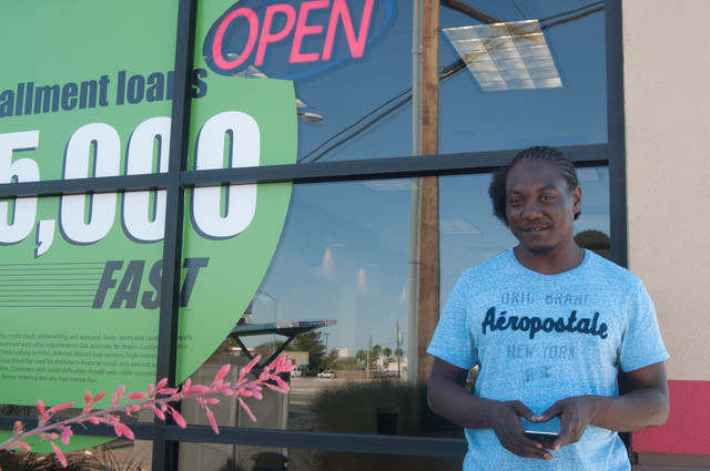 Trey Beasley, 28, said he has never had a problem when taking out payday loans. He stands outside a payday loan store on West Washington Avenue in Las Vegas June 1, 2016. File photo