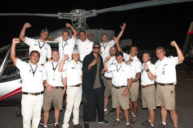 DJ Afrojack with Maverick Helicopters pilots at the Electric Daisy Carnival at Las Vegas Motor Speedway.