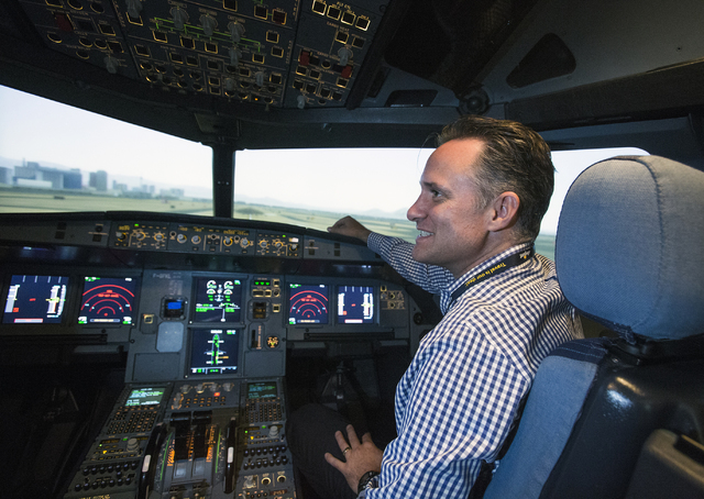 Allegiant Airlines COO Jude Bricker, sits in the cockpit of a flight simulator at the Allegiant training facility in Las Vegas on Thursday, Aug. 4, 2016.  (Jeff Scheid/Las Vegas Review-Journal) Fo ...